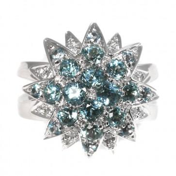 Anello maxi fiore stellato doppio oro, topazi azzurri