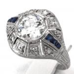 Anello antico decò, platino, diamanti - solitario 1.13 ct + 0.08-0.10 ct - e zaffiri 0.10-0.15; 3.55 gr.