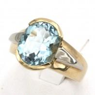 Anello toppa oro bicolore e topazio azzurro; 7.14 gr