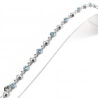 Bracciale tennis oro, diamanti -0.23 ct- e topazi azzurri - 8 ct - 18 cm; 10.9 gr