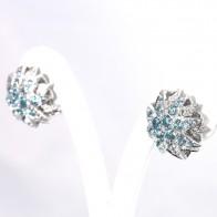 Orecchini al lobo toppa fiore stellato oro, topazi azzurri e diamanti - 0.44 ct; 16.9 gr
