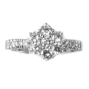 Anello oro fiore  circolare e fronte riviera con diamanti