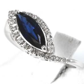 Anello oro, diamanti -0.14 ct- e spola zaffiro -1.05 ct; 4.4 gr
