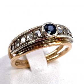 Anello fascia oro, zaffiro e diamanti. 4.27 gr.