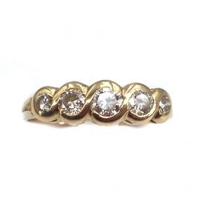 Anello riviera, oro giallo e diamanti -