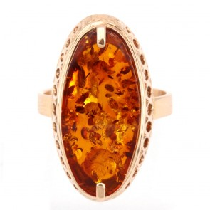 Anello oro e maxi spola ambra