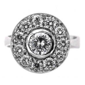 Anello toppa circolare con diamante solitario