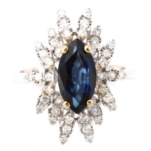 Anello margherita spola iolite e diamanti