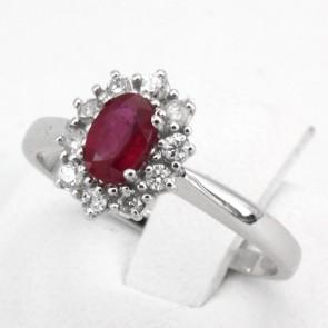 Anello margherita oro, rubino - 0.60 ct - e diamanti - 0.21 ct ; 3.10 gr