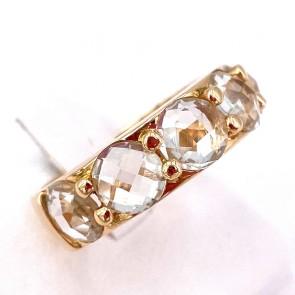 Anello fascia-riviera oro e topazi bianchi; 6.5 gr