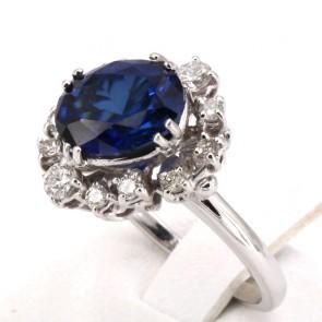 Anello margherita oro, zaffiro - 4.01 ct - e diamanti - 0.55 ct ; 6.58 gr
