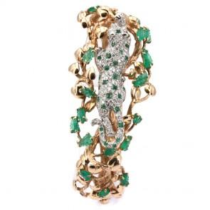 Bracciale capolavoro rigido, oro, smeraldo -12-12.5 ct- e diamanti - 1.58 ct - 63.3 gr. 6.3 cm x 5.5 cm. Con spilla pantera movibile.