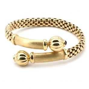 Bracciale rigido incrociato, oro e mini zaffiri cabochon
