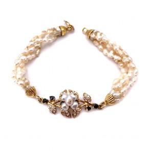 Bracciale in stile in oro, perline,  zaffiri