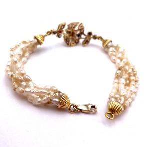 Bracciale in stile in oro, perline,  zaffiri -0.20-0.25 ct- e zirconi. 18 cm; 11.76 gr