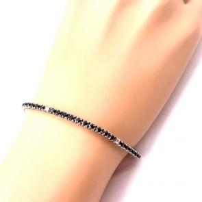 Bracciale tennis oro, spinelli neri - 2.5 ct-  e diamanti 0.28-0.30 ct - 18.5 cm; 9.28 gr.