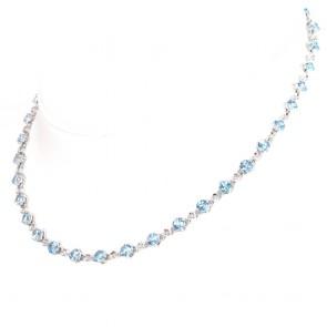 Collana girocollo tennis oro diamanti -0.58 ct- e topazi azzurri -37 ct; 21.9 gr