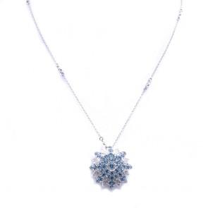 Ciondolo fiore stellato oro, topazi azzurri e diamanti -0.69 ct; 15.2 gr