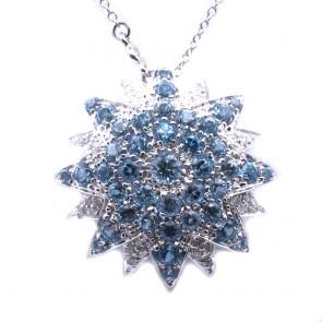 Ciondolo fiore stellato oro, topazi azzurri e diamanti
