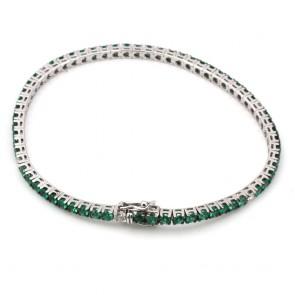 Bracciale tennis oro, diamanti - 0.49 ct - e smeraldi -3.54 ct- 18 cm; 10.33 gr.