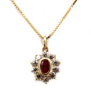 Ciondolo oro a margherita con rubino di sintesi e zirconi;