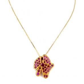 Ciondolo fiore oro, rubini -4.2 ct- 2.7 cm x 2.4 cm; 5.61 gr