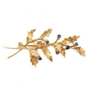 Spilla in stile foglia oro con zaffiri