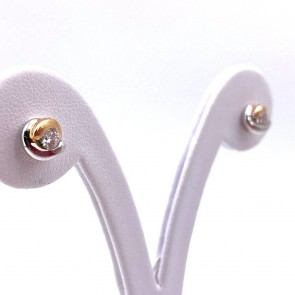 Orecchini punti luce oro bicolore e diamanti - 0.41 ct; 3.67 gr