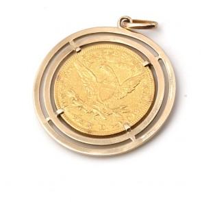 Ciondolo in oro con moneta da 10 dollari americani del 1893, in oro 900/00. 22.5 gr; 4.8 cm x 3.7 cm