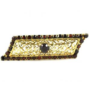 Spilla geometrica in stile, oro traforato e granati